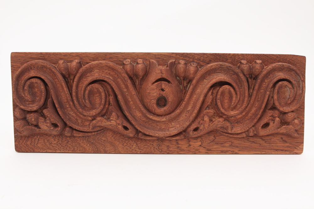 Woodrouting of an ornate fire surround